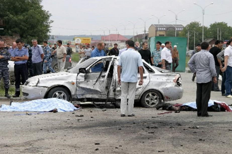 Deux attentats simultanés ont secoué Grozny le 21... (Photo AFP)