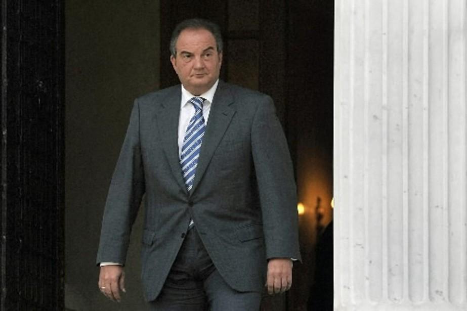 M. Caramanlis a cédé à la pression et... (Photo AFP)
