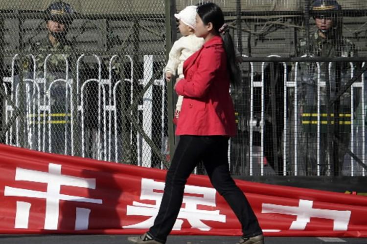 Des habitants au Xinjiang (nord-ouest de la Chine) ont pris... (Photo: Reuters)
