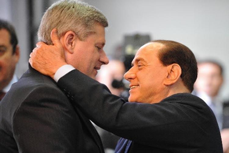 Stephen Harper et Silvio Berlusconi.... (Photo: AFP)