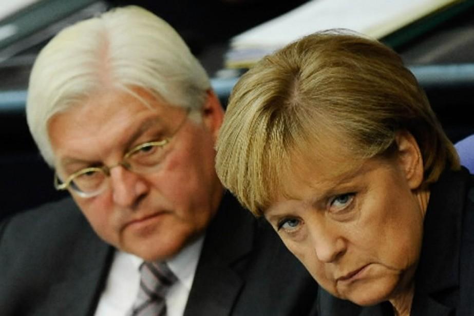 Angela Merkel a dit mardi «regretter profondément» les... (Photo AFP)
