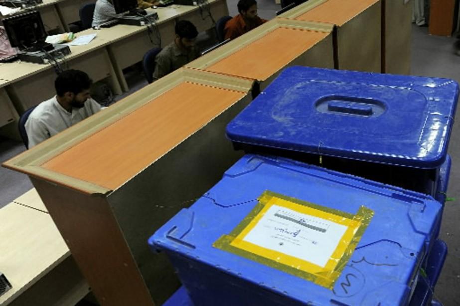 Les bulletins seront recomptés dans tous les bureaux... (Photo AFP)