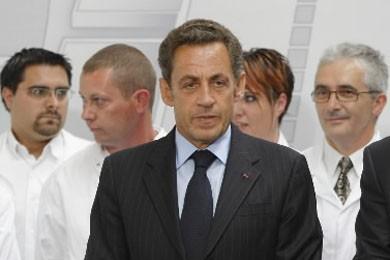Nicolas Sarkozy, qui n'est pourtant pas un homme... (Photo AP)