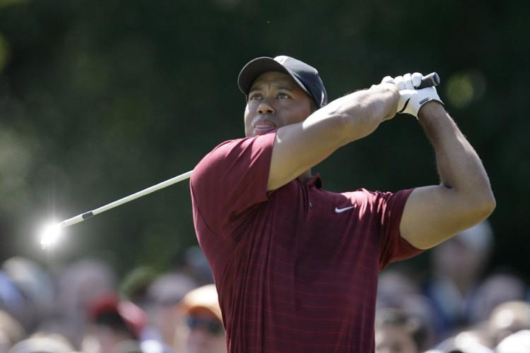Tiger Woods a semé la compétition sur les allées du club de... (Photo: Reuters)
