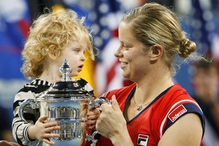 Kim Clijsters a célébré sa victoire en compagnie... (Photo: AFP)