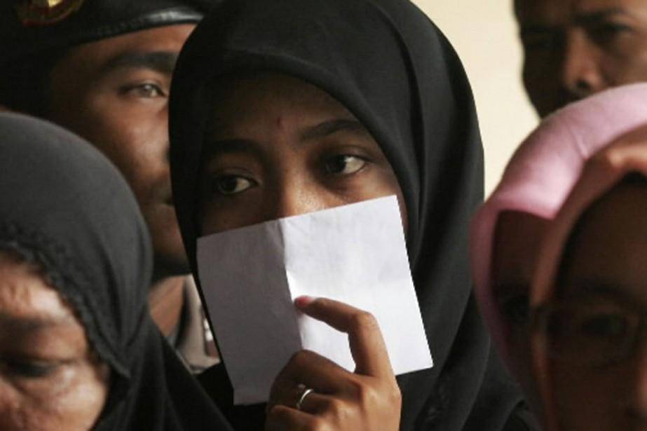 Un groupe de femmes se sont réunies devant... (Photo Reuters)