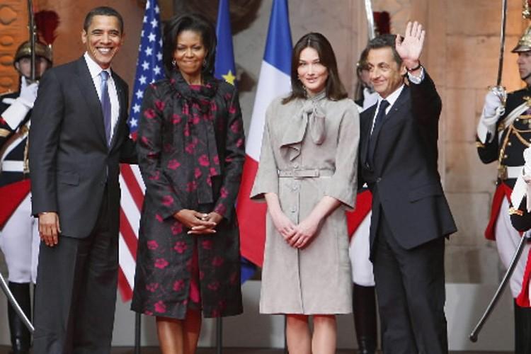 Barack Obama et Nicolas Sarkozy en compagnie de... (Photo: AP)