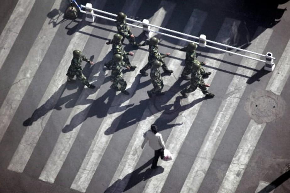 Plus de deux mois après les violentes émeutes... (Photo Reuters)