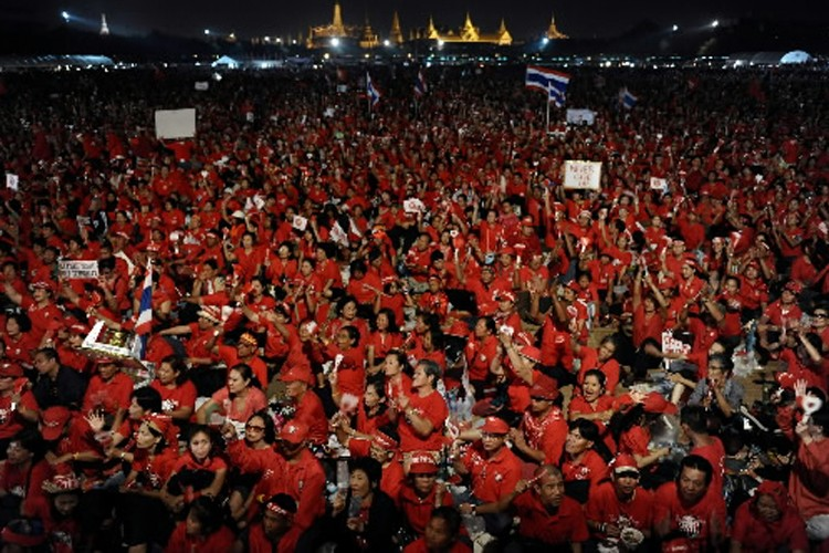 Des partisans des «chemises rouges» lors de leur... (Photo: AFP)