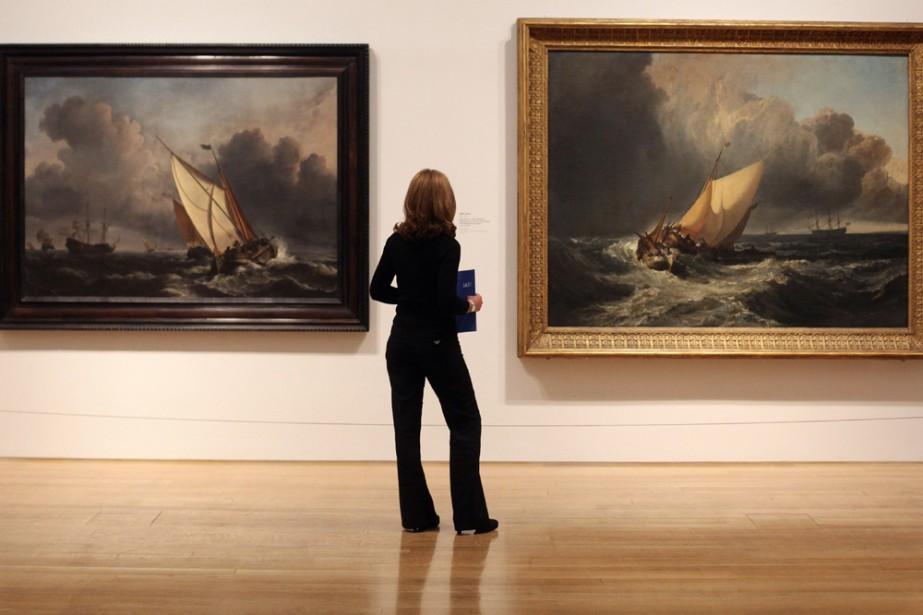 Une jeune femme regarde l'exposition de JMW Turner... (Photo: AFP)