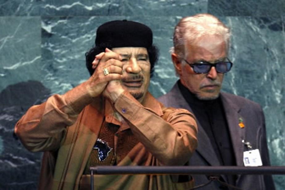 Mouammar Kadhafi a parlé si longtemps que son... (Photo AFP)