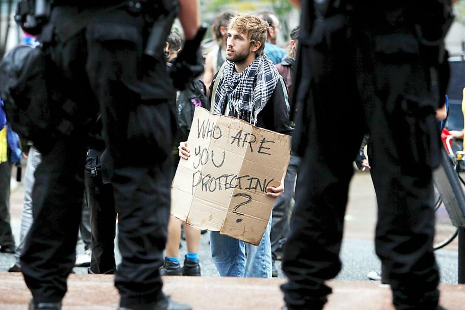 La police a arrêté 14 personnes, la plupart... (Photo AP)