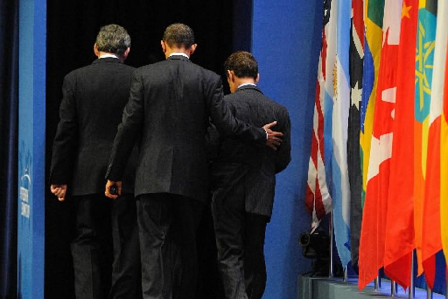 Barack Obama, Nicolas Sarkozy et Gordon Brown se... (Photo AFP)
