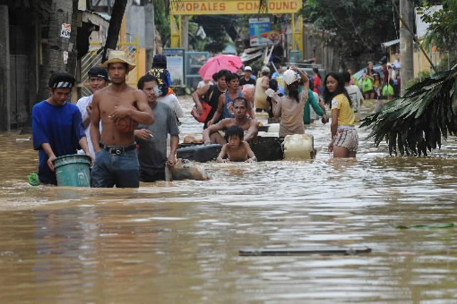 La tempête tropicale qui a balayé Manille et... (Photo AFP)