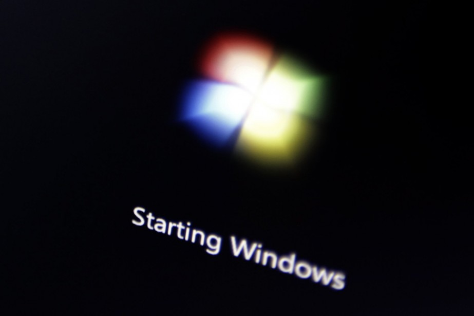 Le logo de Windows 7 affiché sur un... (AP)