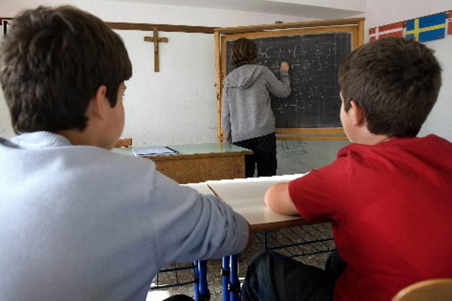 La présence de crucifix dans les écoles fait... (Photo AFP)