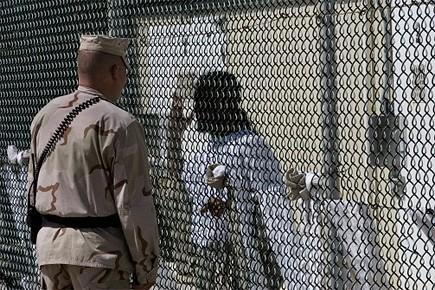 Les cinq Ouïghours restants, comme leurs compatriotes détenus... (Photo: AFP)