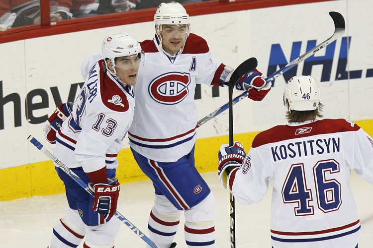Andrei Markov (au centre) a célébré avec Michael... (Photo: Reuters)
