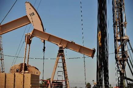 Les prix du pétrole ont encore pris plus d'un dollar à New York... (Photo: AFP)