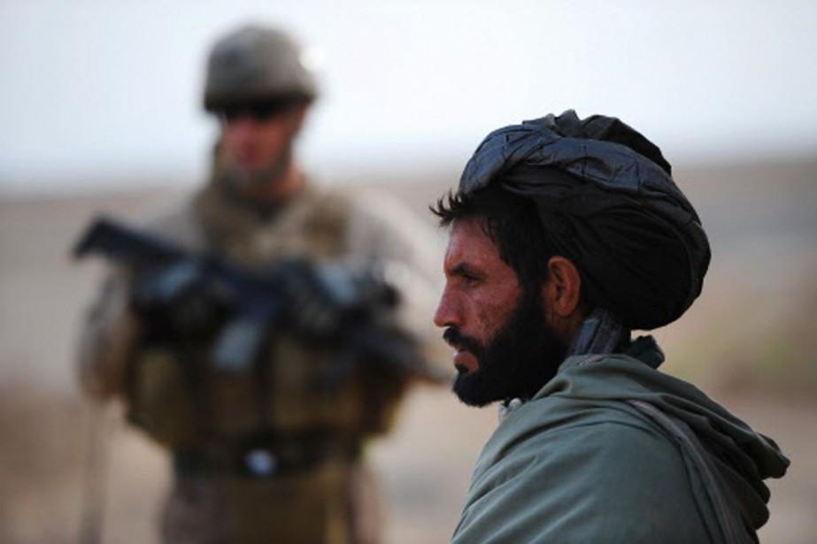 Les Marines ont parfois du mal à contenir... (Photo: AFP)