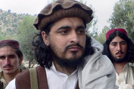 Hakimullah Mehsud en octobre dernier à la frontière... (Photo: AP)