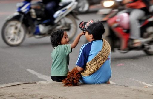 Selon les données officielles, 300 000 enfants vivent... (Photo: AFP)
