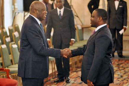 Le président et le premier ministre ivoiriens Laurent... (Photo: Sia Kambou, AFP)