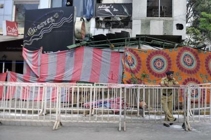 Un policier indien est sur les lieux de... (Photo: Sajjad Hussaon, AFP)