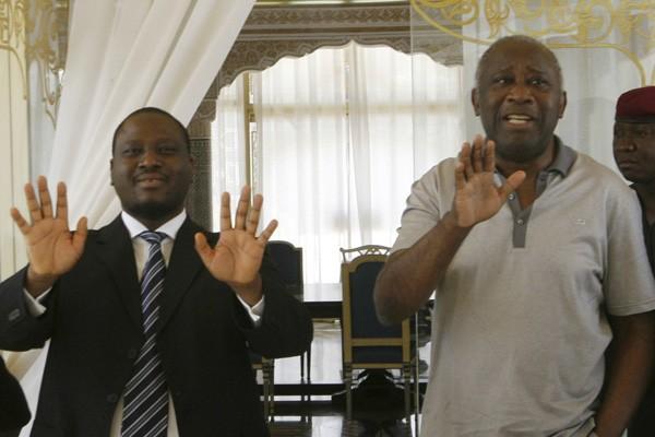 Guillaume Soro, premier ministre et Laurent Gbagbo après... (Photo Reuters)