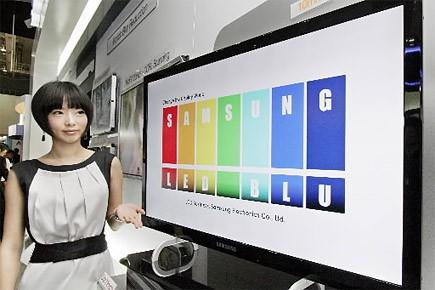 Les Japonais sont obligés de   convertir... (Photo: archives AFP)