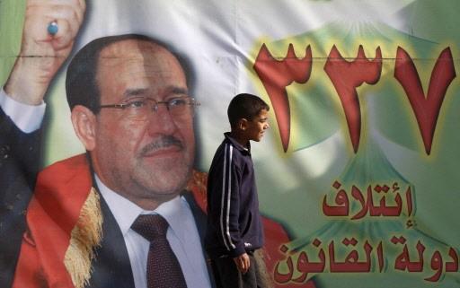Une affiche du premier ministre et candidat Nouri... (Photo: AFP)