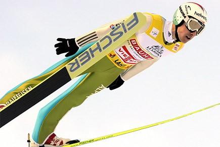 Le Suisse Simon Ammann... (Photo: Reuters)