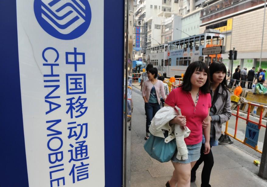 China Mobile est le plus gros opérateur de... (Photo: AFP)