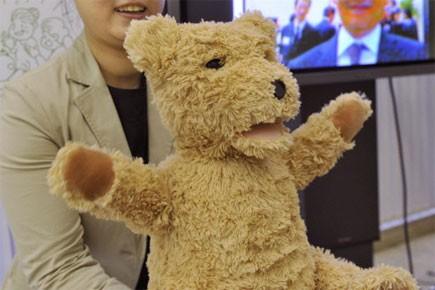 L'ourson de Fujitsu, qui se met parfois à... (Photo: AFP)