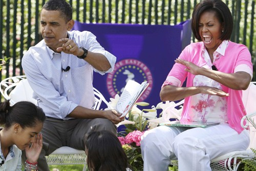 Barack Obama, aux côtés de sa femme Michelle,... (Photo: Reuters)