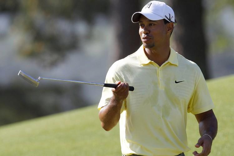 Tiger Woods évoluera en compagnie de K.J. Choi... (Photo: Reuters)
