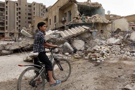 Selon l'ONU, environ 165 milliards de dollars provenant... (Photo: Hadi Mizbanm, AP)