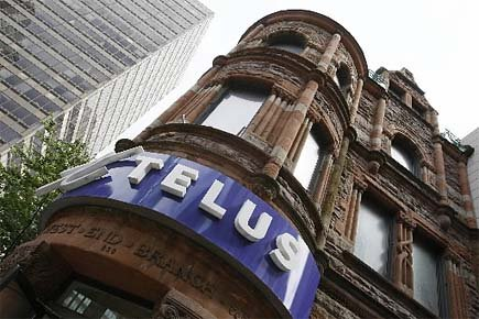 La firme de télécommunications Telus a annoncé,... (Photo Archives Reuters)