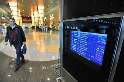 Vols annulés sur le tableau d'affichage de l'aéroport... (Photo AP)