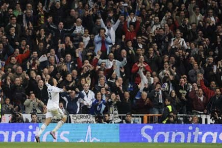 L'international portugais du Real, Cristiano Ronaldo partage sa... (Photo: PIERRE-PHILIPPE MARCOU, AFP)