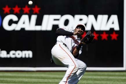 Le voltigeur des Orioles Adam Jones ne peut... (Photo: Ben Margot, AP)