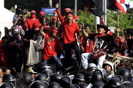 Les «chemises rouges» ont exhorté leurs partisans habitant... (Photo: Sakchai Lalit, AP)