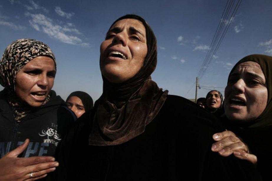 La soeur d'Ali Souweiti a éclaté en sanglots... (Photo: AFP)