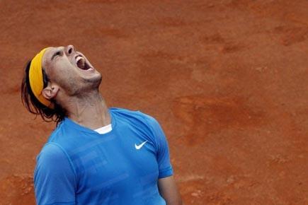 Samedi en demi-finales, Nadal, tenant du trophée, a... (Photo: Stefano Rellandini, reuters)