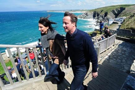Le Conservateur David Cameron et sa femme, en... (Photo AFP)