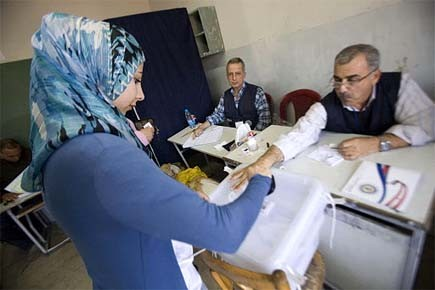 Un total de 7507 candidats, dont 466 femmes,... (Photo: AP)