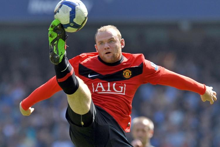 Avec 34 buts depuis l'été passé, Wayne Rooney... (Photo: AFP)