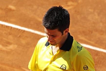 Djokovic souffre de problèmes respiratoires provoqués par une... (Photo: Max Rossi, Reuters)