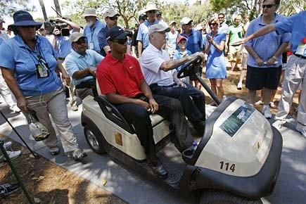 Après avoir exécuté son deuxième coup et Tiger... (Photo: Reuters)
