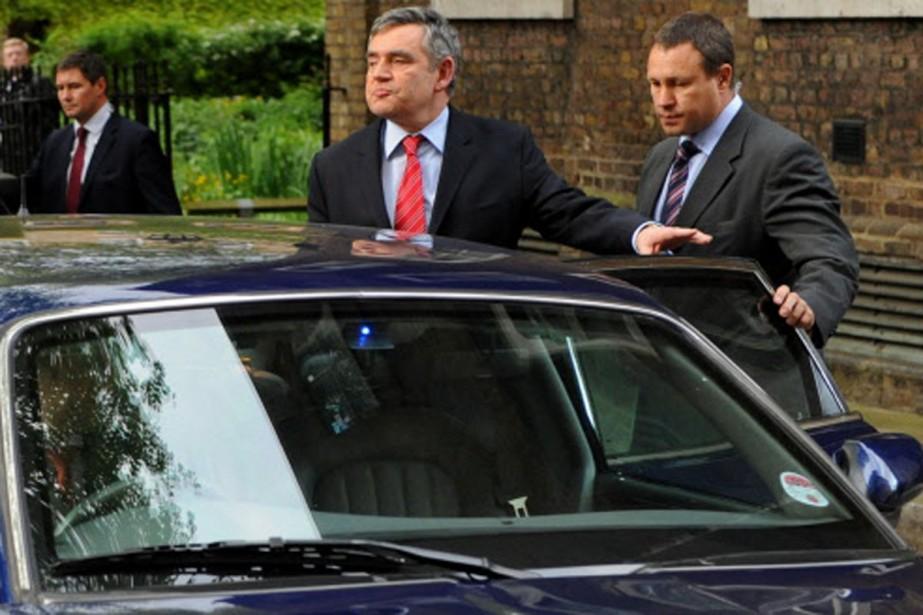 Gordon Brown en route vers le palais de... (Photo: AFP)